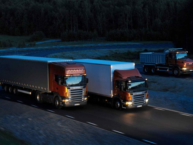 Three-orange-Scania-trucks-1-640x480.jpg